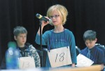 Haley Mayer, of Lakeroad school, takes a turn at the 2014 Sarnia Spelling Bee, held at the Sarnia Library Auditorium and organized by the Organization for Literacy in Lambton. Behind Haley are Isaiah Williams, from P.E. McGibbon, left, and Joey Goodwin, from Lansdowne.