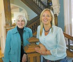 Lawrence House Centre for the Arts board members Lynne Brogden, left, and Susan Chamberlain stand at the historic former home's staircase. Glenn Ogilvie