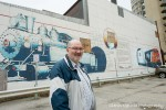 Wayne Wager, chair of the Sarnia Heritage Committee, stands at CN Tunnel Mural in downtown Sarnia, which faces an uncertain future. Glenn Ogilvie
