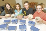 From left, Nicole, Drury, Alexa Soulliere, Chris DeJonghe and Nate Broad, holds coins and bills collected in one week at a Cathcart Boulevard School fundraiser.  Glenn Ogilvie