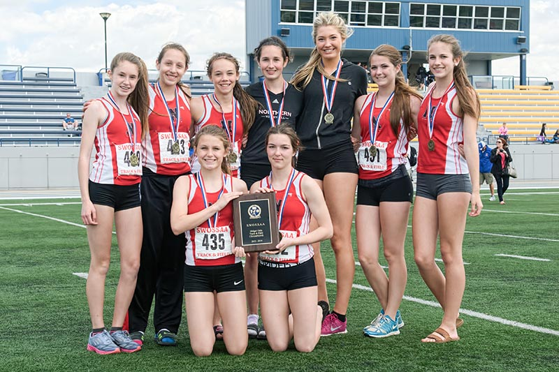 Winner of the women's midget team champion at the SWOSSA track and field finals was Northern Collegiate. Accepting the award here are, from left, back row: Sarah Scott, Abby Whiteye, Steph Shaw, Caitlyn Douglass, Carmen Handy, Steph Maitland and Julie Richmond. Kneeling in front are Skyla Minaker and Marissa Mara. Bruce Smith photo
