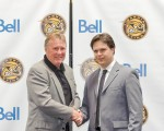 Sarnia Sting President Bill Abercrombie, left, shakes hands with General Manager Nick Sinclair during a recent news conference to announce both appointments. Metcalfe Photography