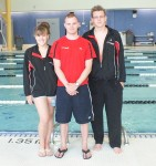 """Maude Boily-Dufour, 13, left, and her brother Samuel Boily-Dufour, 15, right, of the Sarnia Rapids """"Y"""" Swim Team are competing this week at the Swimming Canada Age Group Nationals in Winnipeg. With them is coach Nick Abrametz, centre. Barry Wright"""