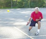 Ray Griffiths returns a serve during a pickleball game at the Germain Park tennis court. Barry Wright