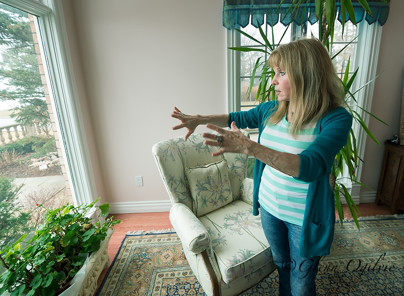 """Shannon Bourke explains her home's design while standing in the northeast corner, which is aligned with the element of """"water."""" Glenn Ogilvie"""