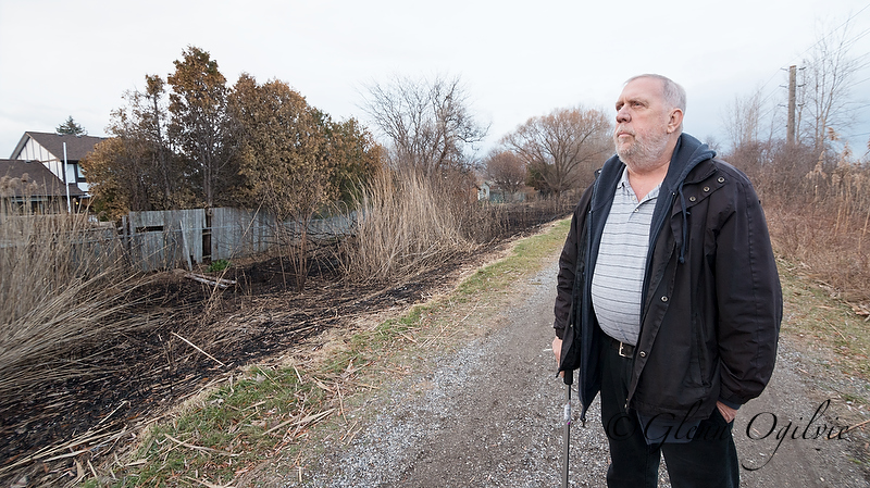Don Salisbury is concerned about the frequent fires that arise from burning phragmites on the Howard Watson Nature, which backs onto his property near the Highway 402 underpass.