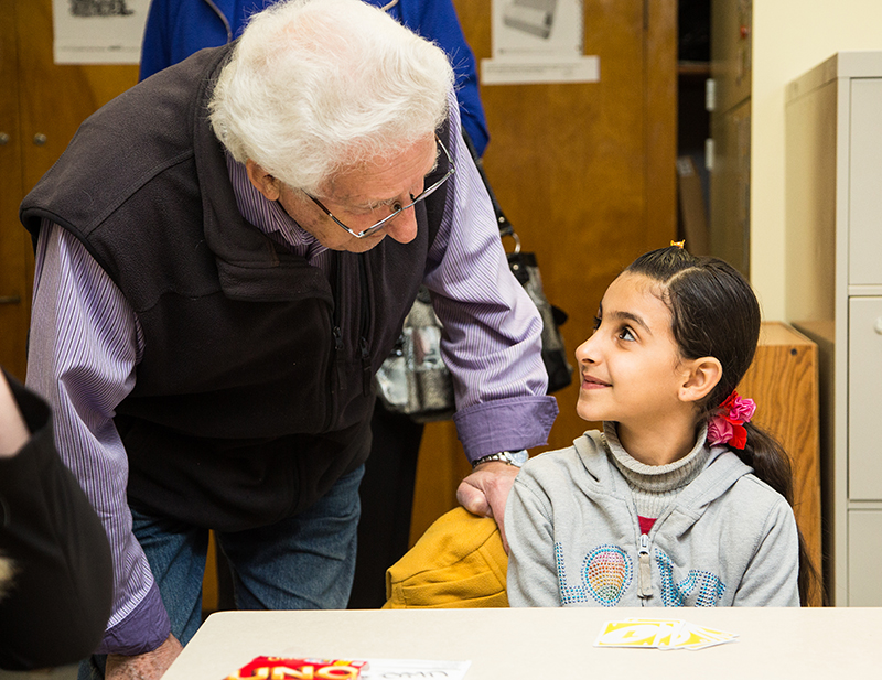 Harry Mennega shares a word with Raghad Al-Khaleel, 8, a member of a Syrian refugee family introduced to the Sarnia community on Friday. Troy Shantz, Special to The Journal