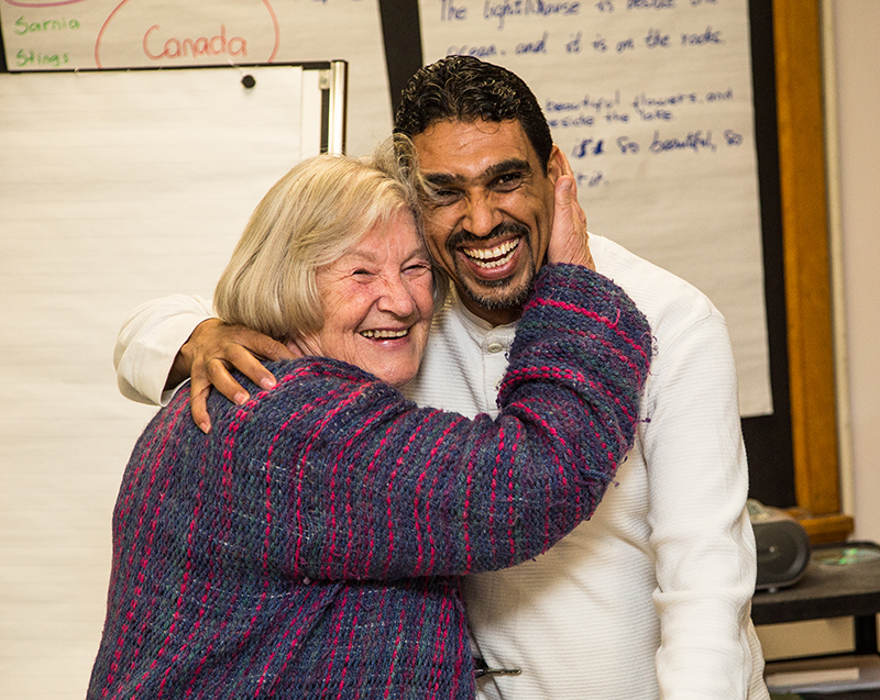 Diane Plug shares a hug with Mohammed Al-Khaleel at the YMCA Learning and Career Centre. Al-Khaleel is the father of a family of five Syrian refugees introduced to the community Friday.  Troy Shantz, Special to The Journal