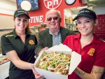 Poutine Hut owner Steve (Theo) Economou shows off an order of Huron poutine with Krista Kelly, left, and Courtney St. Pierre. Glenn Ogilvie