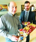Dante Club VP Anthony Iafrate, left, and general manager Giuliano Parete with antipasto boards at the new Amici restaurant. Cathy Dobson