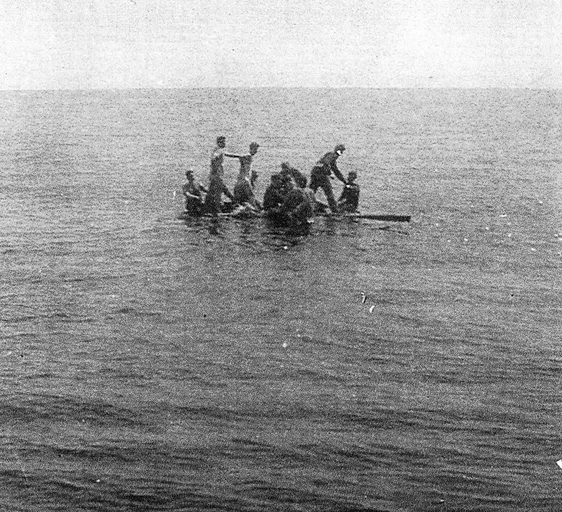 Survivors of the torpedoed HMCS Esquimalt cling to life floats shortly before their rescue by the HMCS Sarnia. Submitted Photo