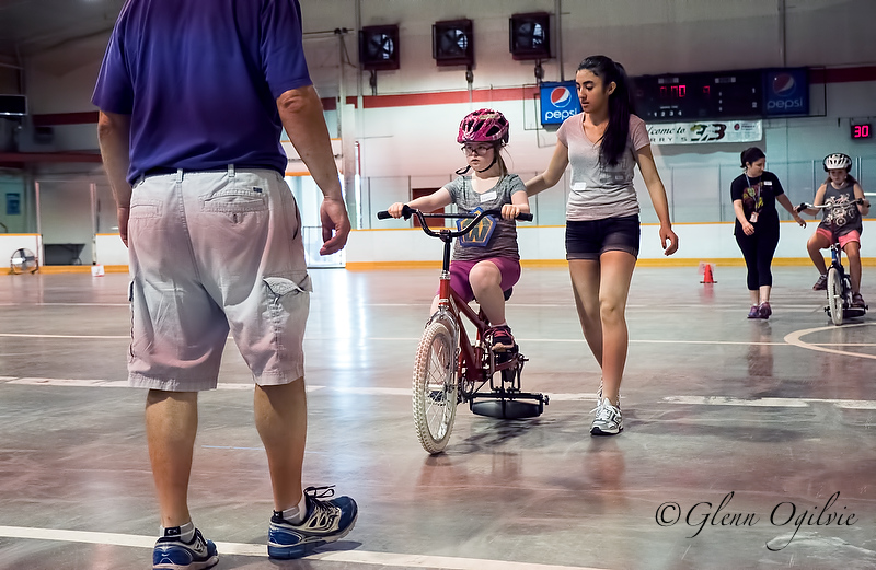 A roller helps keep rider Heather McAllister stable, with additional support from Frank Brennan and Persia Baha. Glenn Ogilvie