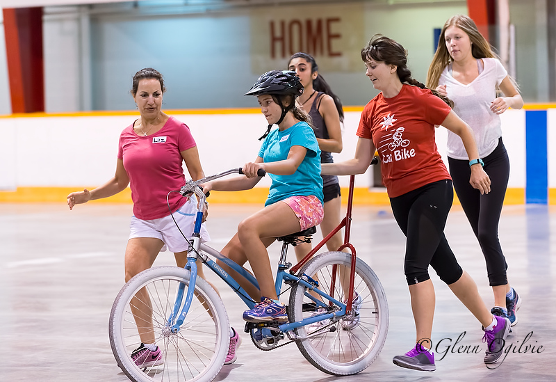 From left, Liz Oliveira, biker Sarah Wight, Persia Baha, iCan Shine instructor Manda Krimmer and Olivia Rodenhuis are nearly ready for Sarah to go solo. Glenn Ogilvie