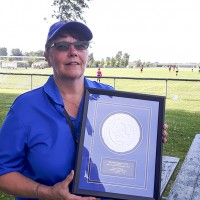 Susan Carnegie with the Meritorious Service Award she received from the Ontario Soccer Association. Dave Paul