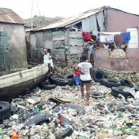 This photo taken Oct. 5, a day after Hurricane Matthew struck Haiti, shows a boat and other debris washed up in the Saint-Marc region. Submitted Photo