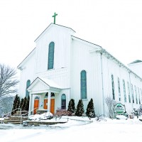 Father Michael Moncoq is buried in the cemetery at St. Joseph's Church in Corunna. Journal file photo