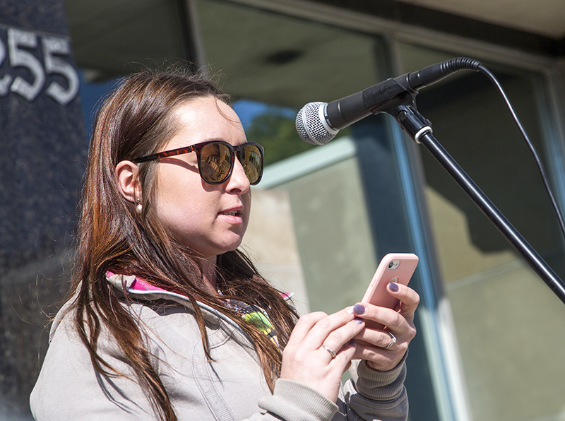 Brook Metcalfe shares her story of overcoming sexual abuse, drug addiction and poverty at the annual Stand Up Against Poverty Rally at City Hall on Friday, October 14.