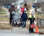 Crossing guard Philip Miller is a 14-year veteran currently controlling the intersection of Indian Road and Oak Street. Here, he helps a group across the busy intersection: Rob Bareness and his daughter Melissa Duguay, 8, Stacey Passingham and her children Lexi Dennis, 5 and Zoe Dennis, 2, in the buggy. In the dark coat is Issac Nahmabin, 9. Glenn Ogilvie
