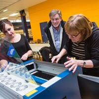 Amanda Knight, left, with the Lambton County Library, shows Ron and Linda Core how to use a laser cutter at the Sarnia Library's Makerspace area. A laser cutter like this one will be among the equipment showcased across the county during Mobile Makerspace Launch events. Troy Shantz