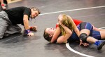Wrestler Nathalie Derechter (in black and purple) of Great Lakes Secondary School tangles with Hannah Wonnacott (in red) of LCCVI in the 51-kg class at the 2017 LKSSA Wrestling Championships on Feb 9. Troy Shantz