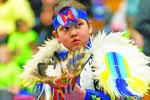Cyrus Sinopole, 11, of Aamjiwnaang First Nation waits for the grand entry for the 23rd annual Lambton College pow wow. Glenn Ogilvie file photo