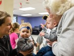 Vision Buddies. from left, Brittany Baril, 10-month-old Arlynn Clarke, four-month-old Lucas Baril, and Vision Nursing Home resident Mary Ross. Troy Shantz