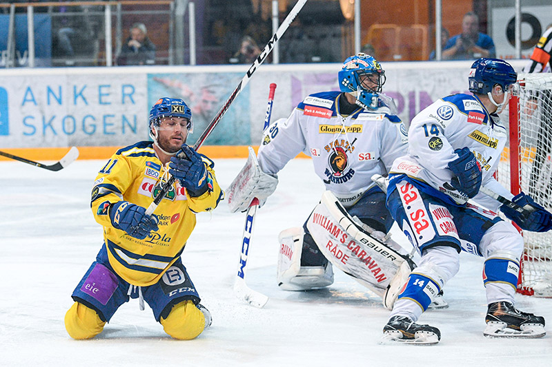An exhausted Joey Tenute, left, during a March 12 playoff game in Norway that became the longest professional hockey game ever played. Photo courtesy, Fredrik Olastuen