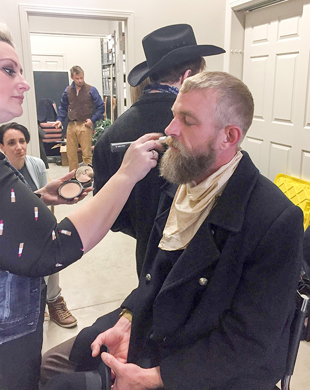 Jessica Hext of Sarnia's Crave Costmetics Studio prepares cast members for a scene from Black Donnellys, a new film by Aaron Huggett. Submitted Photo