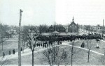 "Veteran's Park is seen in this rare 1900 photo of a ""Welcome Home"" celebration for returning Boer War soldiers. In the background is the second Congregational Church at the corner of Victoria and Wellington streets. The now spireless building is today an apartment complex. Photo courtesy, Sarnia: A Picture History of the Imperial City, by Glen C. Phillips"