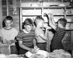 Clean-up duties were a part of life for summer campers at Camp Kenny, later known as Camp Lamrecton. Here, Lee Abrams, Raymond Wheeler, John Stewart and Bill Peters wash and put away dishes during a summer camp held in 1950. Photo courtesy, Lambton County Archives, Sarnia Observer Negative Collection (00967-00).