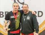 Boady Santavy with coach and father Dalas Santavy after winning the best lifter award at the Canadian Junior Championships in January.  They'll be joined by Noah Santavy at the world juniors in Tokyo this summer. Submitted Photo
