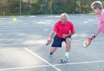 Early pickleball aficionado Ray Griffiths returns a serve during a pickleball game played on the Germain Park tennis courts. Journal file photo