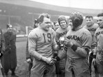 Frank Dombrowski of the U.S. Army congratulates Canadian Captain Bill Drinkwater following the 'Tea Bowl' game played at White City Stadium in London, England in 1944.  Photo courtesy Capt. Jack H. Smith/ Dept. of National Defence