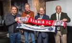 Representing of the Vancouver Whitecaps, from left, academy director Marianos Papageorgopoulos and director of soccer development Dan Lenarduzzi, hold up banners with Sarnia FC club president Tom Lacroix and head coach Paul Burke. Troy Shantz