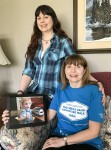 Sandi and her mom Diane Viggers, right, hold a photo of their nephew and grandson,who had a heart transplant at nine weeks. Cathy Dobson