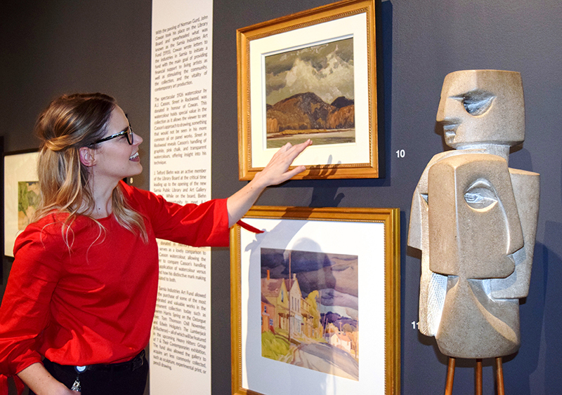JNAAG Assistant Curator Sonya Blazek discusses a Group of Seven painting by A.J. Casson that is being exhibited for the first time. Cathy Dobson