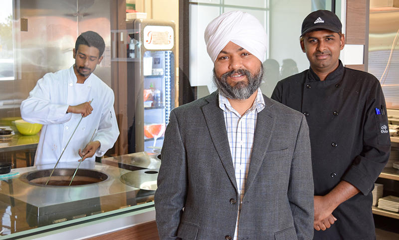 Ash Mathon, centre, co-owner of the new Warraich Bar & Grill, with chefs Vipin Gopal, right, and Shrijeet Mondal.