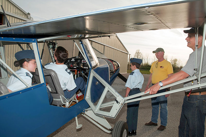 Three members of the 44 Squadron Air Cadets, from left, Flight Corporal Mika Magtanong, LAC Andrew McCully and Sergeant Johnathan Hemstreet, check out an aircraft at Sarnia Chris Hadfield Airport along with Bill Pedlar and Mark Seibutis, members of COPA Flight 7. Darren McKeegan Photo