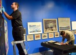 Senior preparator Dale Workman, left, and assistant preparator Stephen Korzenstein, hang the 44 paintings for the new Heavy Hitters show at the Judith and Norman Alix Art Gallery. Cathy Dobson
