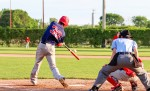 Julian Service of the Sarnia Braves hits a home run during a  game last year against Courtright. Service has been ian important part in the Braves lengthy win streak this season.  Photo by Hayley Trigatti