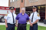 Sarnia Fire Chief John Kingyens, left, history writer Phil Egan, and Deputy Fire Chief Bryan Van Gaver, right, at the Clifford Hansen Fire Station on East Street, where a public open house is planned July 15. Cathy Dobson